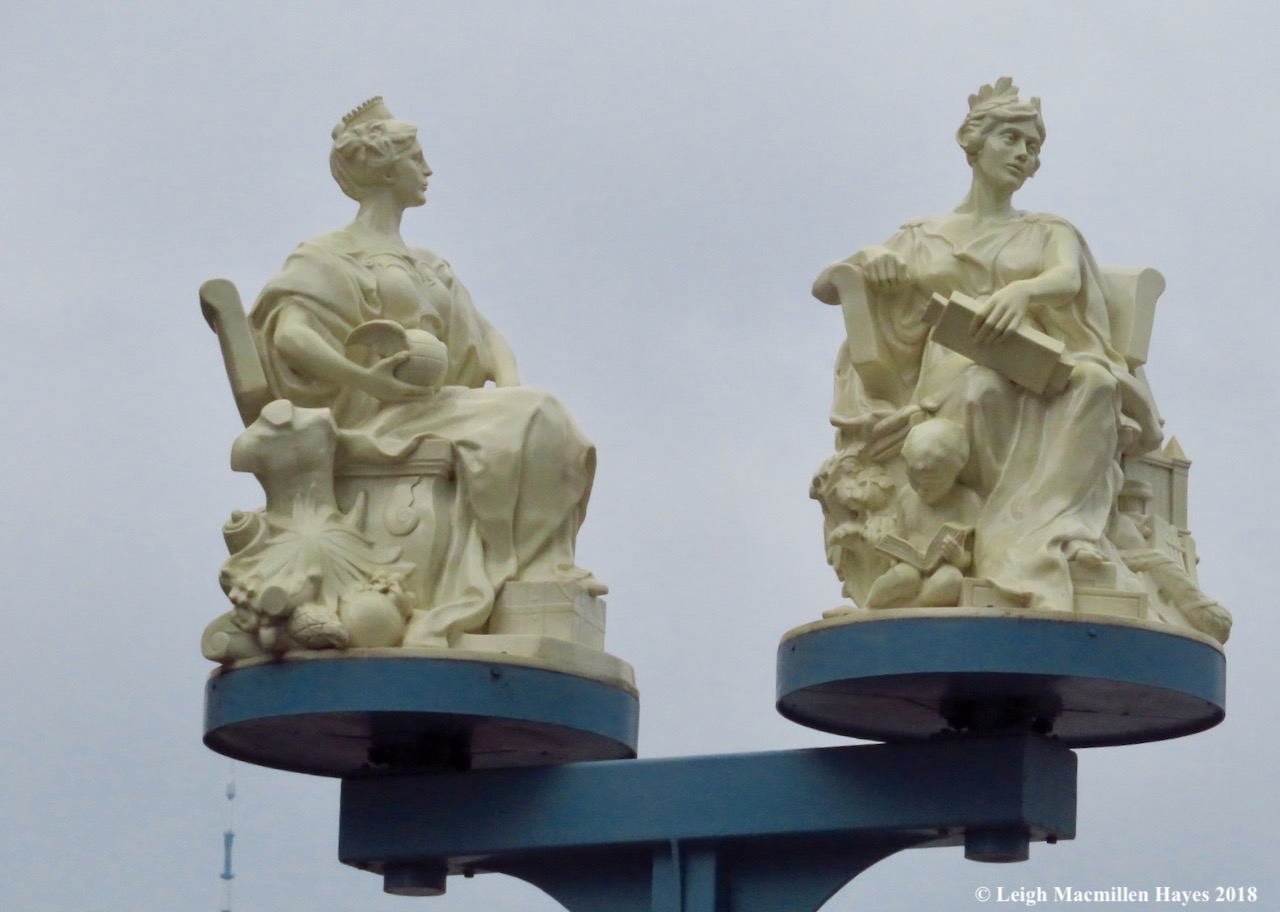 40-rotating statues of Miss Brooklyn and Miss Manhattan